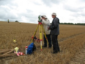 "Steve and Tony with the ""total station"" used to survey the site."
