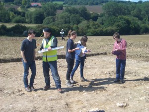 Jez instructing volunteers in trench recording