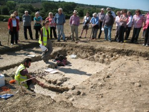 Cotswold Archaeology Project Leader explaining the different levels of trench 4 - possibly the main entrance