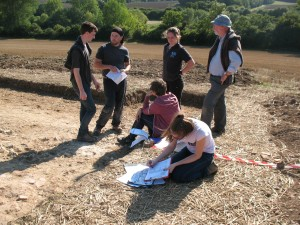 It might be the Open Day but volunteers are learning from Jez, how to accurately describe the different levels of a trench